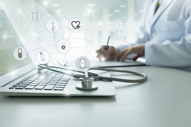 Doctor using a laptop computer contact with patient. Concepts of technology communication, medical online network.